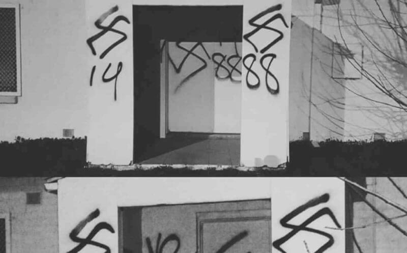 "A supplied image obtained Sunday, July 31, 2016 of an Adelaide mosque vandalised with anti-Muslim slogans and neo-Nazi symbols. ""They've tried to set it on fire, smashed our windows with their rocks and now swastikas on the doors of our masjid (mosque),"" Imran Lum, whose family runs the converted house in Elizabeth Grove, wrote on Facebook. Police confirmed they are investigating the incident but are unsure exactly when it happened. (AAP Image/Imran Lum Facebook)) NO ARCHIVING, EDITORIAL USE ONLY"